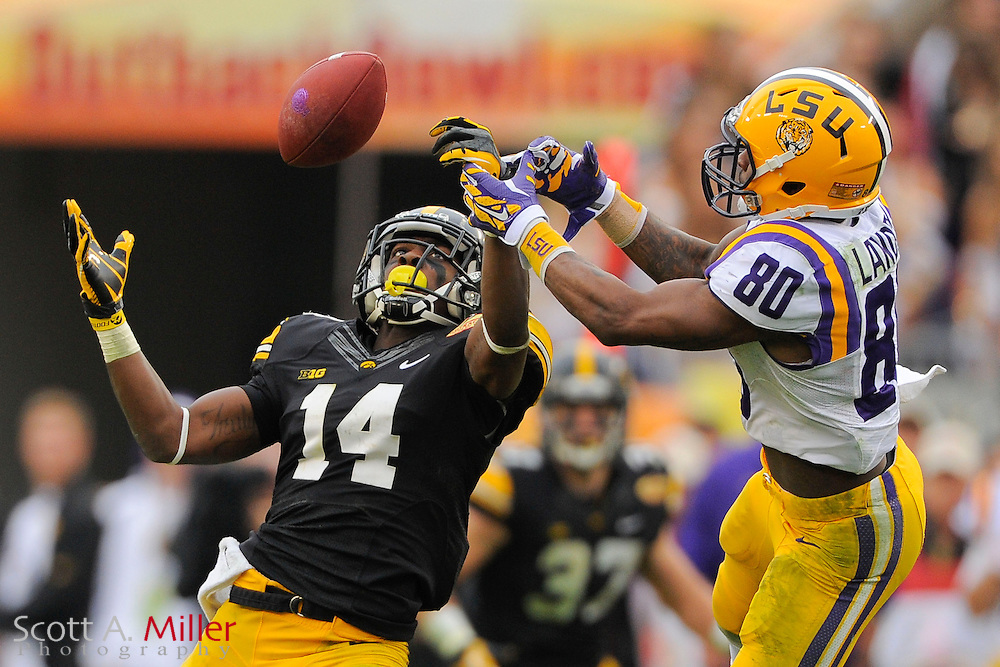 Iowa Hawkeyes defensive back Desmond King (14) breaks up a pass intended for LSU Tigers wide receiver Jarvis Landry (80) during LSU's 21-14 win in the 2014 Outback Bowl at Raymond James Stadium on Jan 1, 2014  in Tampa, Florida.            ©2014 Scott A. Miller