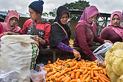 Vegetables vendors buy wholesale vegetables directly from farmers in a market in Boyolali, Central Java, 2018.