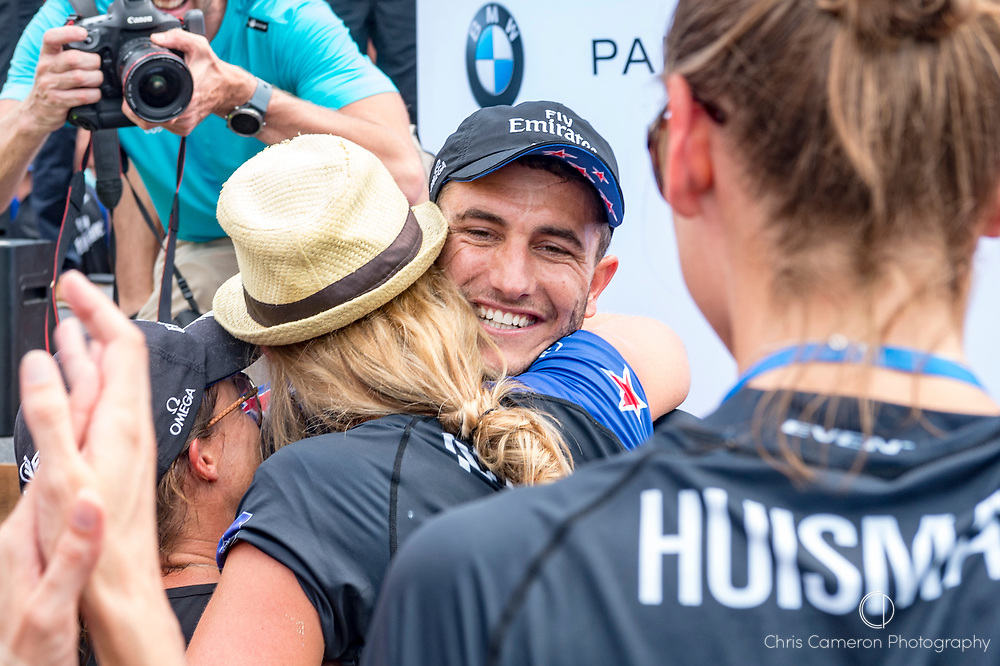 The Great Sound, Bermuda, 26th June 2017. Emirates Team New Zealand sailor Blair Tuke being hugged by family members after winning the America's Cup.