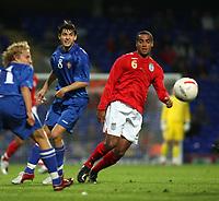 Photo: Chris Ratcliffe.<br /> England U21 v Moldova U21. European Championship Qualifier. 15/08/2006.<br /> Tom Huddlestone of England U21 clashes with Alexandru Gatcan of Moldova U21.