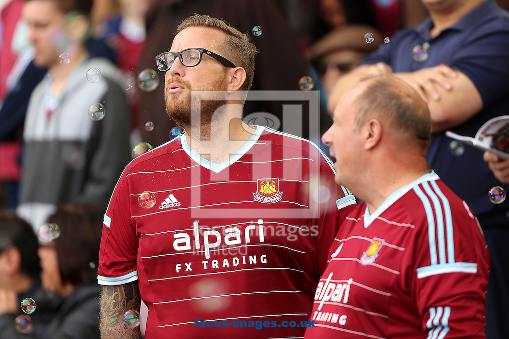 A fan of West Ham United blowing bubbles before the Barclays Premier League match against Queens Park Rangers at the Boleyn Ground, London<br /> Picture by Richard Calver/Focus Images Ltd +447792 981244<br /> 05/10/2014
