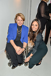 Left to right, DAME TANNI GREY-THOMPSON and OLIVIA WAYNE at the London premier of Being AP held at Altitude 360, Millbank Tower, 30 Millbank, London on 23rd November 2015.