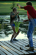 Outdoor recreation, Fishing, Father and Daughter Catch Fish,