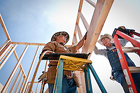 JEROME A. POLLOS/Press..Roger Jefcoat, left, from Laurel, Miss., and Roland Kennedy, from Jewett, Texas, completes the framing of a doorway Monday at the site of Grace Baptist Church in Post Falls. Members of The Master's Builders traveled from across the country to help construct the new church.