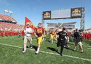 September 10, 2011: Iowa State Cyclones head coach Paul Rhoads and Iowa State Cyclones defensive lineman Jake McDonough (94) lead the team onto the field before the start of the game between the Iowa Hawkeyes and the Iowa State Cyclones during the Iowa Corn Growers Cy-Hawk game at Jack Trice Stadium in Ames, Iowa on Saturday, September 10, 2011. Iowa State defeated Iowa 44-41 in 3OT.