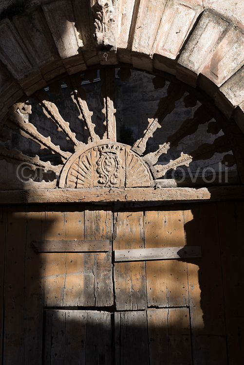 Old door in the high part of the city, so called Civita or Piano