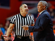 CHAMPAIGN, IL - DECEMBER 08: NCAA basketball official Larry Scirotto talks with Head coach Marvin Menzies of the UNLV Rebels during the game against the Illinois Fighting Illini at State Farm Center on December 8, 2018 in Champaign, Illinois. (Photo by Michael Hickey/Getty Images) *** Local Caption *** Larry Scirotto; Marvin Menzies