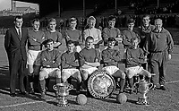 Linfield FC, Belfast, N Ireland, team photo, August 1966. Sitting (left to right):    Standing (left to right): Tommy Leishman, Ken Gilliland, Stan Greg,  Ronnie White, Iam McFaul, Arthur Thomas, Bryan Hamilton and Jimmy McCune (trainer); Sitting (left to right) Jackie Patterson, ?????, Sammy Hatton, Phil Scott and Billy Ferguson. 196608000018.<br /> <br /> Copyright Image from Victor Patterson, Belfast, UK<br /> <br /> t: +44 28 9066 1296 (from Rep of Ireland 048 9066 1296)<br /> m: +44 7802 353836<br /> <br /> victorpattersonbelfast@gmail.com<br /> www.victorpatterson.com<br /> <br /> Please see my Terms and Conditions of Use at https://www.victorpatterson.com/page2<br /> It is IMPORTANT that you familiarise yourself with them.<br /> <br /> Images used online incur an additional cost and must be visibly watermarked i.e. © Victor Patterson within the body of the image and copyright metadata must not be deleted. Images used on the Internet have a size restriction of 4kbs and are chargeable at rates available at victorpatterson.com.<br /> <br /> This image is only available for the use of the download recipient i.e. television station, newspaper, magazine, book publisher, etc, and must not be passed on to any third party. It is also downloaded on condition that each and every subsequent usage is notified within 7 days to victorpattersonbelfast@gmail.com<br /> <br /> The right of Victor Patterson to be identified as the author is asserted in accordance with The Copyright Designs And Patents Act (1988). All moral rights are asserted.