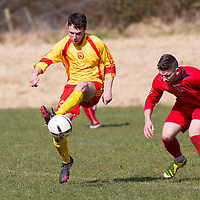 Avenue Utd's Paddy O'Malley keeps the ball watched by Lifford's John Allen