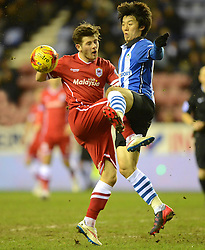 Wigan Athletic's Bo-Kyung Kim competes with Cardiff City's Matthew Kennedy - Photo mandatory by-line: Richard Martin-Roberts/JMP - Mobile: 07966 386802 - 24/02/2015 - SPORT - Football - Wigan - DW Stadium - Wigan Athletic v Cardiff City - Sky Bet Championship