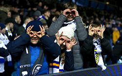 Young Leeds United fans in the stands make a binocular gesture during the Sky Bet Championship match at Elland Road, Leeds.
