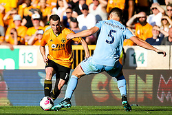 Diogo Jota of Wolverhampton Wanderers takes on James Tarkowski of Burnley - Mandatory by-line: Robbie Stephenson/JMP - 25/08/2019 - FOOTBALL - Molineux - Wolverhampton, England - Wolverhampton Wanderers v Burnley - Premier League
