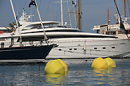 Ultra-rich spectators dock their luxury boats at the superyacht marina in Port America's Cup; Valencia, Spain.