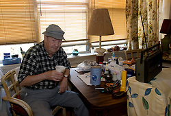 03 Sept  2005. New Orleans, Louisiana. Post hurricane Katrina.<br /> Shocked residents of the St Christopher's Inn retirement home were abandoned by their carers on the eve of the storm and left to fend for themselves.Running low on water, food and cigarettes, Tommy 'The Hat' Lennon (76yrs) tried his best to remain calm before residents were rescued six days later by New Orleans 8th district police.<br /> Photo Credit ©: Charlie Varley/varleypix.com