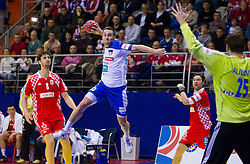 Luka Zvizej of Slovenia vs Mirko Alilovic of Croatia during handball match between Slovenia and Croatia in  2nd Round of Preliminary Round of 10th EHF European Handball Championship Serbia 2012, on January 18, 2012 in Millennium Center, Vrsac, Serbia. Croatia defeated Slovenia 31-29. (Photo By Vid Ponikvar / Sportida.com)