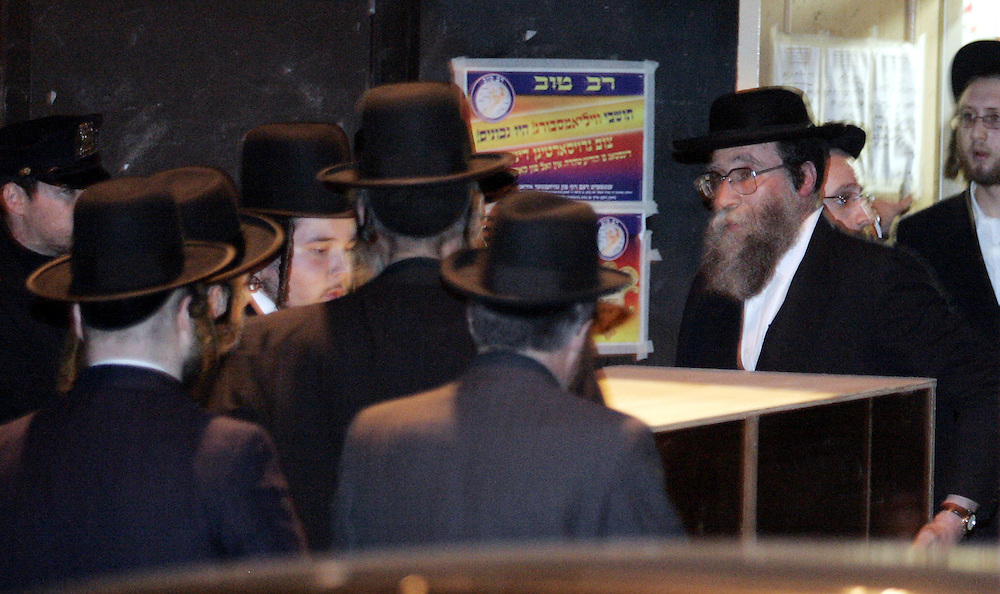 The body of Grand Rabbi Moses Teitelbaum, worldwide spiritual leader of tens of thousands of members of the ultra-Orthodox Jewish sect, Satmar Hassidim, is carried into the Yetev Lev D'Satmar synagogue in Brooklyn, New York after he died in New York City at the age of 91 Monday 24 April 2006.