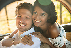 Portrait of Smiling Couple inside Car