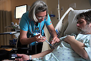 """Joan Wortman injects medicine into the IV of patient Donald Hill, of Williamstown, during his stay at Gifford Medical Center in Randolph, Vt. Monday, May 2, 2016. """"I work to support the farm,"""" said Wortman. """"You know the old joke, I go to the real job to support the hobby job.""""  (Valley News - James M. Patterson) Copyright Valley News. May not be reprinted or used online without permission. Send requests to permission@vnews.com."""