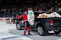 KELOWNA, CANADA - DECEMBER 2: The Kelowna Rockets begin cleaning up teddy bears on the ice after the Conner Bruggen-Cate #20 of the Kelowna Rockets scores a goal triggering the annual toss against the Kootenay Ice on December 2, 2017 at Prospera Place in Kelowna, British Columbia, Canada.  (Photo by Marissa Baecker/Shoot the Breeze)  *** Local Caption ***