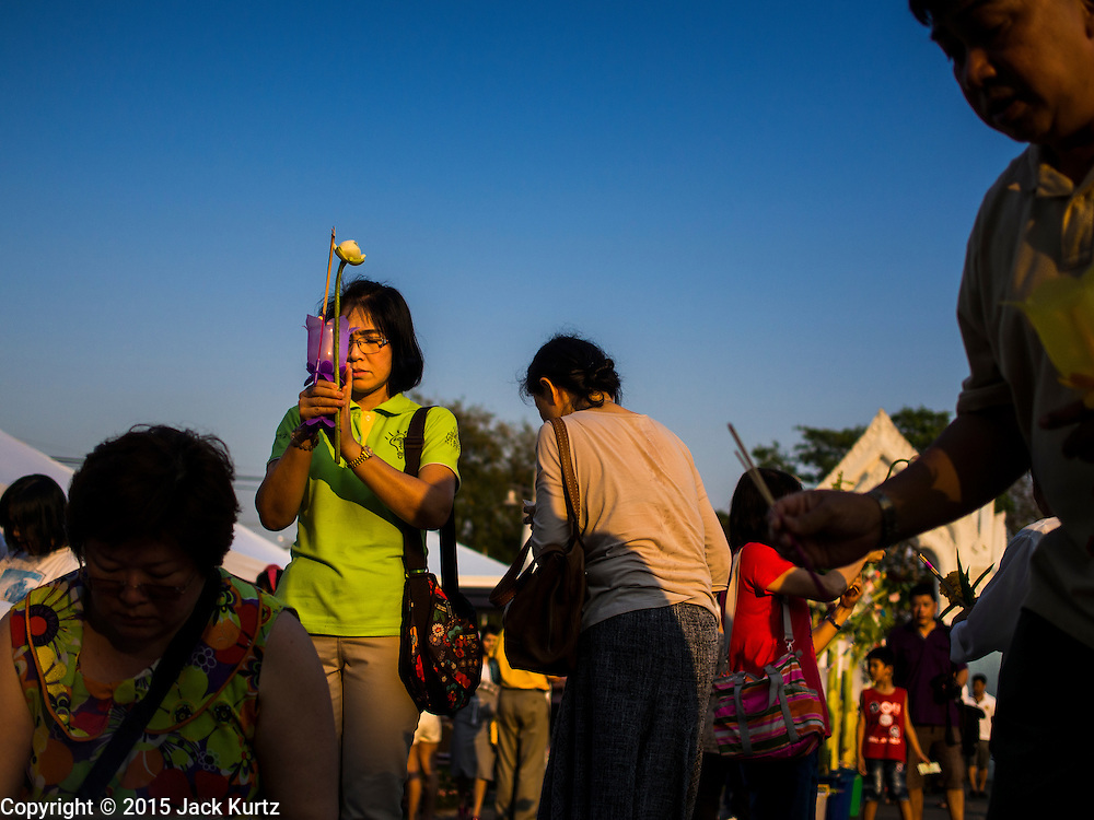 04 MARCH 2015 - BANGKOK, THAILAND: People pray at Wat Benchamabophit on Makha Bucha Day. Makha Bucha Day is an important Buddhist holy day and public holiday in Thailand, Cambodia, Laos, and Myanmar. Many people go to temples to perform merit-making activities on Makha Bucha Day. Wat Benchamabophit is one of the most popular Buddhist temples in Bangkok.    PHOTO BY JACK KURTZ