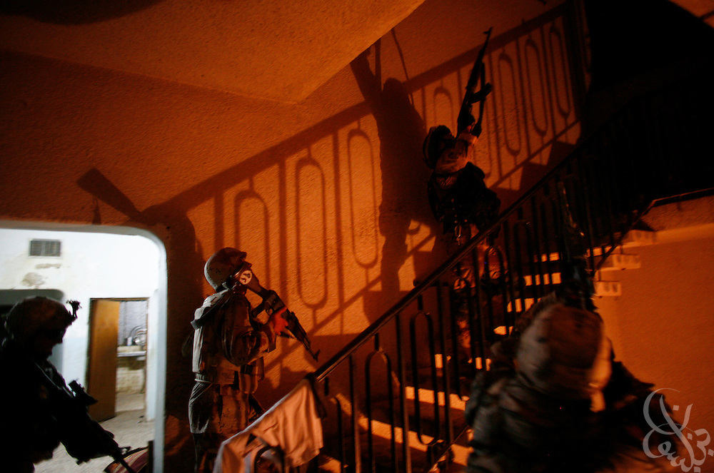 Soldiers from the U.S. Army 172nd Stryker Brigade and the 6th division, 2nd battalion Iraqi Army search an Iraqi house in the Amariyah district of Baghdad during an ongoing joint U.S.-Iraqi security operation in the Iraqi capital August 13, 2006.