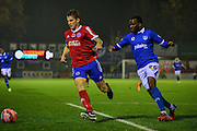 Craig Westcarr chasing down during the The FA Cup match between Aldershot Town and Portsmouth at the EBB Stadium, Aldershot, England on 19 November 2014.