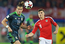 VIENNA, AUSTRIA - Thursday, October 6, 2016: Wales' Gareth Bale in action against Austria's Marcel Sabitzer during the 2018 FIFA World Cup Qualifying Group D match at the Ernst-Happel-Stadion. (Pic by David Rawcliffe/Propaganda)