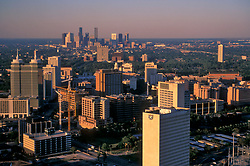 Stock photo of an aerial view of the Medical Center and downtown Houston skyline at dusk
