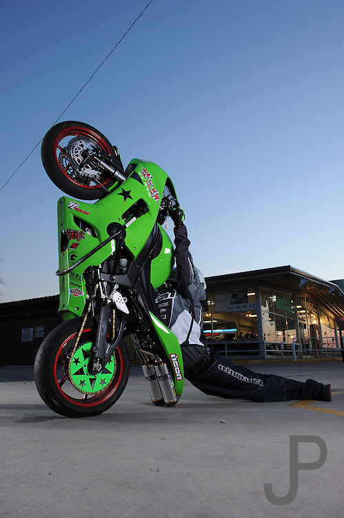 Eric Hoenshell on his House of Kawasaki sponsored ZX-6 stunt bike in front of House of Kawasaki showroom