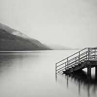 Steps leading into lake at Loch Lomond, Highlands, Scotland, UK