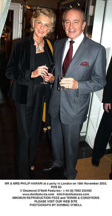 MR & MRS PHILIP HARARI at a party in London on 18th November 2003.<br /> POS 85