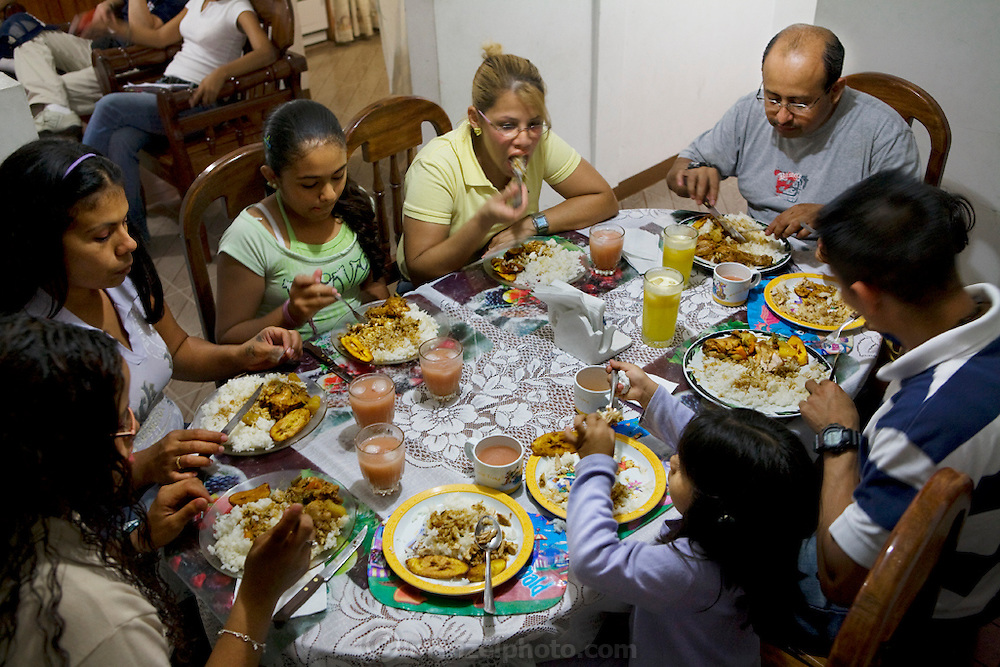 High school student Katherine Navas and her family eat dinner at their home in Caracas, Venezuela.  (From the book What I Eat: Around the World in 80 Diets.) Dinner at Katherine's house is a family affair. Her mother is the chief cook, but everyone helps. Tonight's dinner is fresh fried fish from an uncle's shop. During meals, the television is turned off and the day's events are recounted by even the youngest.