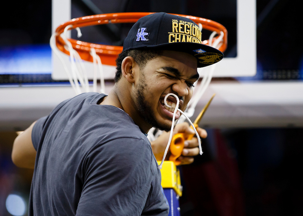 Kentucky Wildcats forward Trey Lyles (41) holds a piece of net in his teeth after the game against the Notre Dame Fighting Irish in the finals of the midwest regional of the 2015 NCAA Tournament at Quicken Loans Arena. Kentucky won 68-66. Mandatory Credit: Rick Osentoski-USA TODAY Sports