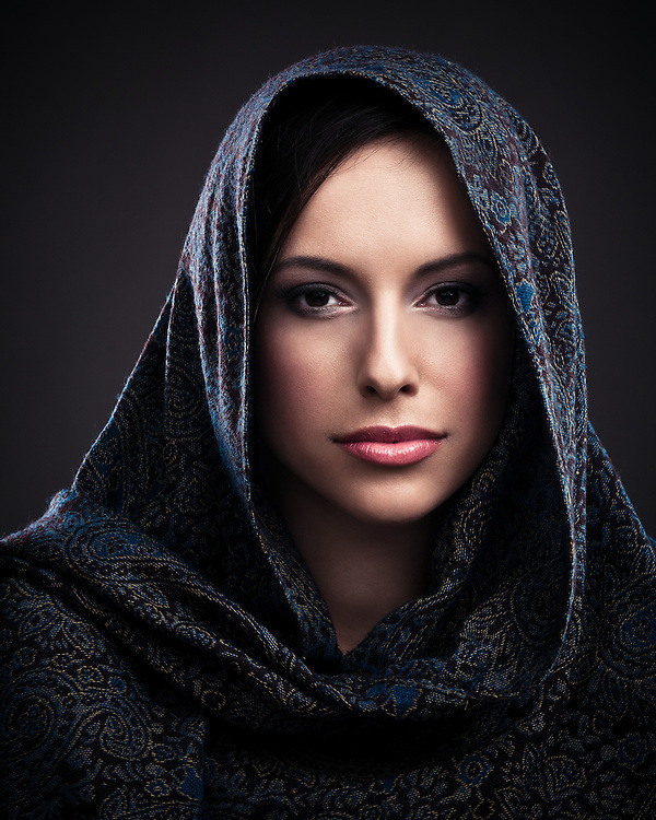 Portrait of a beautiful mysterious woman wearing a headscarf.