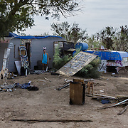 While most of the year round residents in Slab City are older, there are some younger people as well.  Most of the residents have at least one dog - often 3 or 4 - for protection. Living in a squatter community can be dangerous at times, especially when people run out of money at the end of the month, and when they first get paid at the beginning. The heat exacerbates everything.