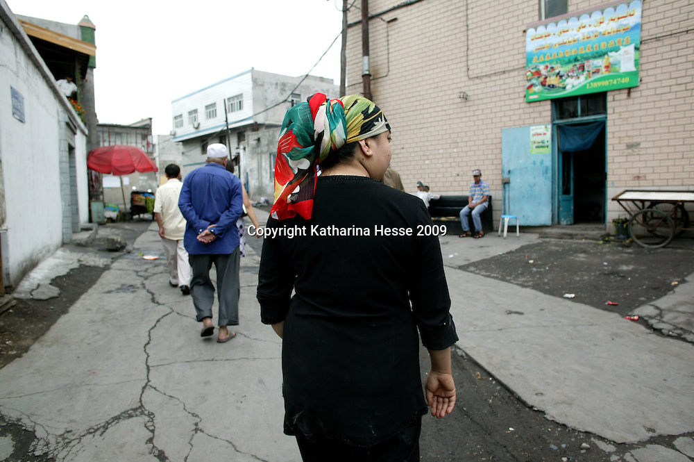 "URUMQI, JULY-15 : "" They threw a shirt over his head and led him away without saying a word,"" said his wife, Resuangul while walking in an alley in Urumqi's Xiangyang Po district,   a poor quarter of the city dominated by Uighurs, Turkic-speaking Muslims who have often had an uneasy relationship with China's Han majority. Uighurs are the largest ethnic group in Xinjiang, but in Urumqi, Han make up more than 70 percent of the 2.3 million residents.<br /> Many Han Chinese were killed in Xiangyang Po during the protests in early July 2009."