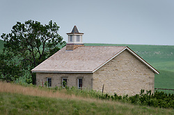 The The Lower Fox Creek Schoolhouse is located in the Tallgrass Prairie National Preserve in the Kansas Flint Hills. The school, on the National Historic Register of Historic Places, was built on land donated by cattleman Stephen F. Jones. Built in 1882, the one-room school had its first classes in 1884. Typical enrollment was between one to 19 students of all grades. The school was closed in 1930 and restored in 1968 by the Garden Clubs in the Mid-East District of Kansas. The 10,894-acre Tallgrass Prairie National Preserve is located in Chase County near the towns of Strong City and Cottonwood Falls. Less than four percent of the original 140 million acres of tallgrass prairie remains in North America. Most of the remaining tallgrass prairie is in the Flint Hills in Kansas. Tallgrass Prairie National Preserve is the only unit of the National Park Service dedicated to the preservation of the tallgrass prairie ecosystem. The Tallgrass Prairie National Preserve is co-managed with The Nature Conservancy. NOTE: A comparison of this photo with an two-month earlier burning of the prairie is available. See photo id# I0000pM2aeeuFTvk