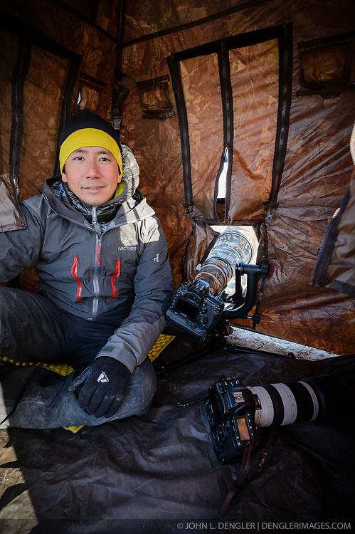 Wildlife photojournalist Noppadol Paothong poses for a photo in his blind in southwest Wyoming. ©John L. Dengler / DenglerImages.com