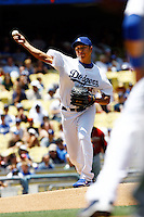 19 July 2009: Pitcher #18 Hiroki Kuroda throws the ball to first base during the MLB Los Angeles Dodgers 4-3 win over the Houston Astros on a warm summer day in LA at Chavez Ravine during a National League Professional Baseball game.