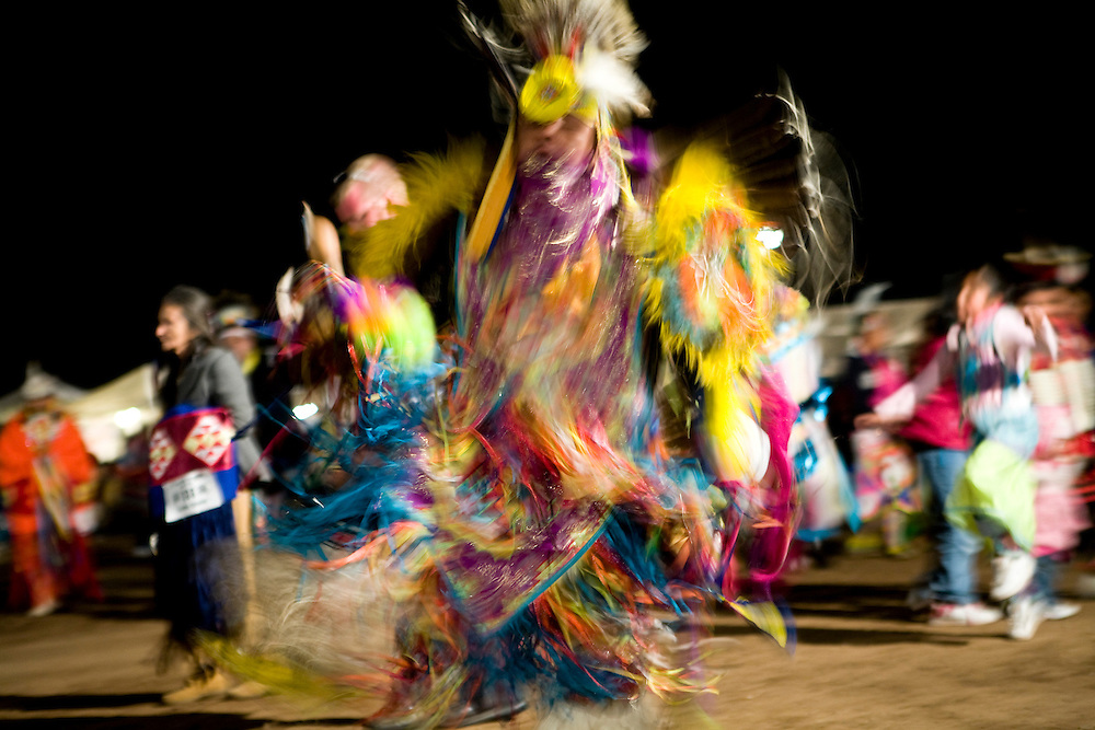 A man dances at a powwow during the annual rodeo and carnival on the Tohono O'odham Native American reservation in Sells, Arizona, on Saturday, Feb. 2, 2008. The rodeo has been taking place for 70 years and is the largest Indian rodeo in Arizona.