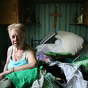Margaret Cregan, a 68 years old lady at her place in West house .Margaret who suffers from demencia has been left at her place with water been flooding since April 17. Her family complain that the council has done nothing to sort it out her situation. London April 2011