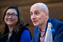 © Licensed to London News Pictures. 13/01/2018. London, UK. Lord Andrew Adonis speaks in the 'Planes, Trains and Automobiles' debate next to senior Labour advisor and chair of the debate Ayesha Hazarika (left) at the Fabian Society 2018 Conference. The overall conference title is 'Policy Priorities for the Left'. Photo credit : Tom Nicholson/LNP