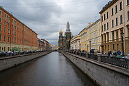 St. Petersburg, Russia -- July 20, 2019. A shot looking down a canal headed for the Church of the Spilled Blood  in St Petersburg.