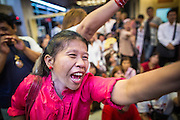 03 MARCH 2013 - BANGKOK, THAILAND: . Pheu Thai supporters scream in anger when it was announced that MR Sukhumbhand Paribatra, the incumbent running on the Democrat ticket, had won the election for Bangkok governor. Pongsapat Pongchareon, running on the Pheu Thai ticket, lost the Bangkok's Governor's race to MR Sukhumbhand Paribatra, the incumbent running on the Democrat ticket. Sukhumbhand won the race after scoring a record number of votes, more than 1.2 million to Pongsapat's 1 million. The results were seen as an upset even though Sukhumbhand was the incumbent because all of the pre-election polls and the exit polls conducted on election day showed Patsapong winning.    PHOTO BY JACK KURTZ