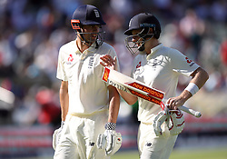 England's Alastair Cook and Joe Root (right) leave the field after the first session during day one of the First Investec Test match at Edgbaston, Birmingham.