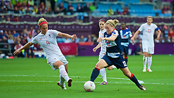 COVENTRY, ENGLAND - Friday, August 3, 2012: Great Britain's Kim Little (R) and Canada's Carmelina Moscato during the Women's Football Quarter-Final match between Great Britain and Canada, on Day 7 of the London 2012 Olympic Games at the Rioch Arena. Canada won 2-0. (Photo by David Rawcliffe/Propaganda)