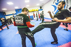 Students kicking the rear of the area of the hoop, Stef Noij, KMG Instructor from the Institute Krav Maga Netherlands, at the IKMS G Level Programme seminar today at the Scottish Martial Arts Centre, Alloa.