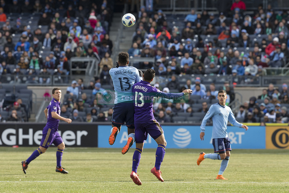 March 17, 2018 - New York, New York, United States - Mohamed El-Munir (13) of Orlando City SC and Saad Abdul-Salaam (13) of NYC FC fight for ball during regular MLS game at Yankee stadium NYC FC won 2 - 0 (Credit Image: © Lev Radin/Pacific Press via ZUMA Wire)