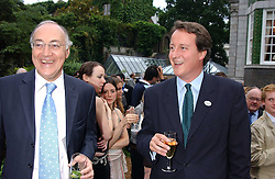Left to right, MICHAEL HOWARD MP and DAVID CAMERON MP at the No Campaign's Summer Party - a celebration of the 'Non' and 'Nee' votes in the Europen referendum in France and The Netherlands held at The Peacock House, 8 Addison Road, London W14 on 5th July 2005.<br />