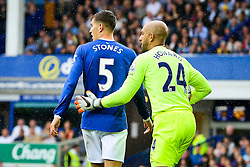 Everton's Tim Howard gives a pat on the back to John Stones after some good defending - Mandatory byline: Matt McNulty/JMP - 07966386802 - 23/08/2015 - FOOTBALL - Goodison Park -Everton,England - Everton v Manchester City - Barclays Premier League